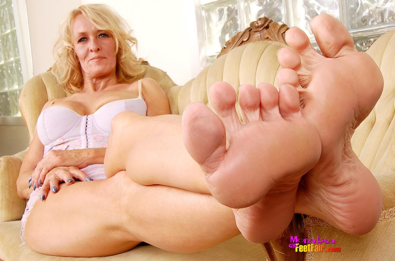Mature Foot Domination Photo